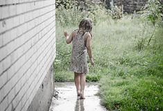 Girl under the rain Stock Images