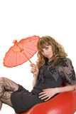 Girl under an red umbrella Royalty Free Stock Photography
