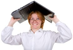Girl under a roof from the laptop Stock Photography