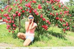 Girl under roses Stock Photo