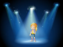 A girl under the spotlights Stock Image