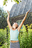 Girl under summer rain. Hands up Royalty Free Stock Image