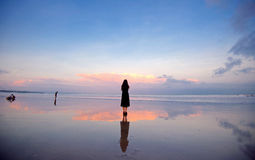 A girl under the sunset of Bali island. On the seaside of bali island (Lembongan island), Indonesia Stock Photos