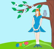 Girl under the tree with Easter eggs Stock Photography