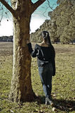 Girl under the tree. A teenager looking to the horizontal alone and under a tree in a nice spring day in Mar del Plata, Argentina Royalty Free Stock Photos