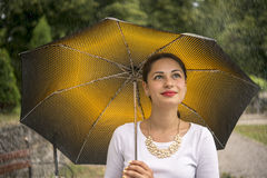 Girl under an umbrella in the rain Royalty Free Stock Images