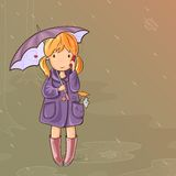 Girl under an umbrella talking on Cell Phone Stock Images