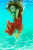 Girl under water Stock Photos