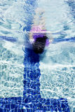 Girl Under Water On A Pool. Girl diving under water on a pool Royalty Free Stock Photo