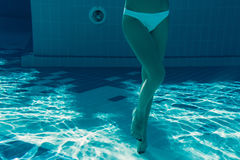 Girl under water Stock Images