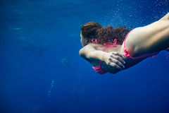 Swimming girl in blue sea royalty free stock photography