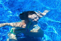 Girl underwater in a pool Stock Images