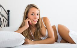 Girl in underwear on bed Royalty Free Stock Images