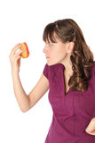 Girl unhappy with donut Royalty Free Stock Image