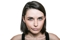 Girl with unhappy expression Stock Image