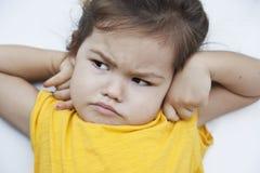Girl with an unhappy face Stock Photos