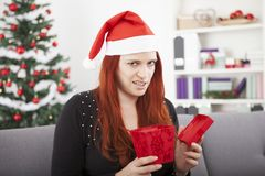 Girl is really unhappy with gift box for christmas Royalty Free Stock Images