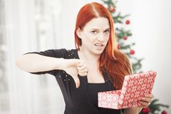 Girl is really unhappy with gift box for christmas Stock Images