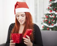 Girl is unhappy open christmas present Stock Photo