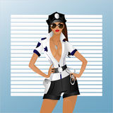 The girl in uniform. A beautiful girl in a uniform similar to the police is on the background of the blinds Royalty Free Stock Image