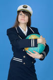 Girl in uniform embrace globe Royalty Free Stock Photos