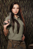 Girl uniform with a gun. Camouflage. Stock Photography