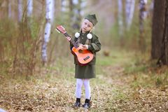 Girl in uniform for the holiday May 9 stock photography