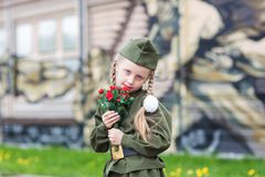 Girl in uniform for the holiday May 9 stock photo