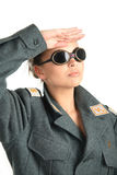 A girl in uniform saluted. Young girl in sun glasses saluted Royalty Free Stock Photography