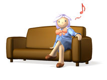 Girl in uniform is  sitting on the sofa. Royalty Free Stock Photos