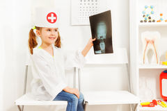 Girl uniformed as doctor with skull radiography Royalty Free Stock Photos