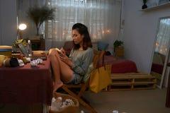 Girl in university dorm. Vietnamese university student doing homework in her dorm Royalty Free Stock Photos