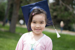 Girl in the university hat Stock Images