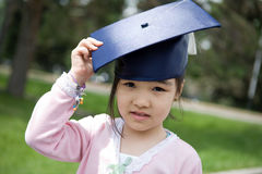 Girl in the university hat Stock Photos