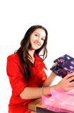 Girl unpack gifts Stock Image