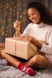 Girl unpacking christmas gift box Royalty Free Stock Photo