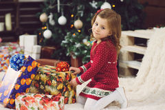 Girl Unpacking Colorful Present Box Royalty Free Stock Images