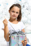 Girl unpacking gift Stock Images