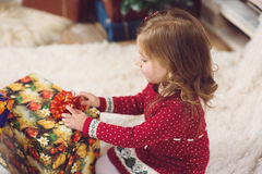 Girl Unpacking Present Box Stock Image