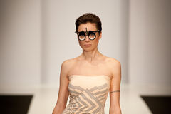 Girl in unusual glasses. Model demonstrating to the Russian high fashion week outfit from designer OSMAN. Russian Fashion Week in Moscow. Photo taken on: April Stock Photo