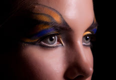 Girl and unusual make-up. Close up royalty free stock image