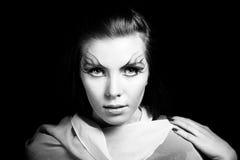Girl and unusual make-up. Close up. BW photo Stock Image