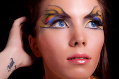 Girl and unusual make-up. Close up royalty free stock images