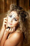 Girl with an unusual make-up as a leopard Royalty Free Stock Images