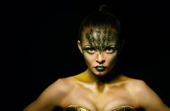 Girl with unusual makeup crocodile Royalty Free Stock Photography