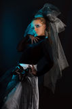 A girl with an unusual theatrical makeup. In the dark tones Stock Image