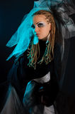 A girl with an unusual theatrical makeup. In the dark tones Royalty Free Stock Photos