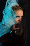 A girl with an unusual theatrical makeup. In the dark tones Royalty Free Stock Photo