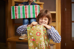 Girl unwrapping a Christmas present Stock Photography