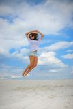 Girl up in the air. Teenager having fun and enjoys summer Royalty Free Stock Photo